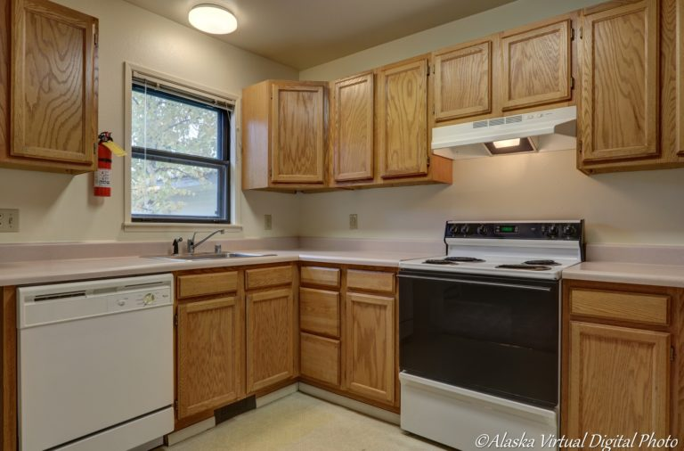 Photo of kitchen including oven, dishwasher and sink