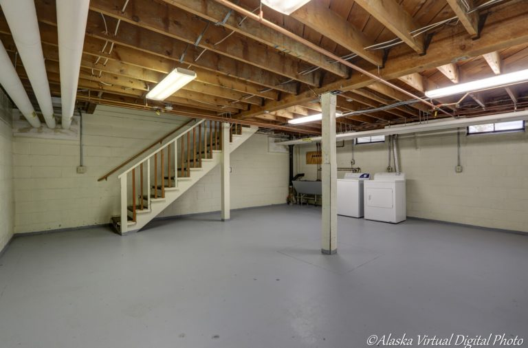 Photo of unfinished basement with laundry