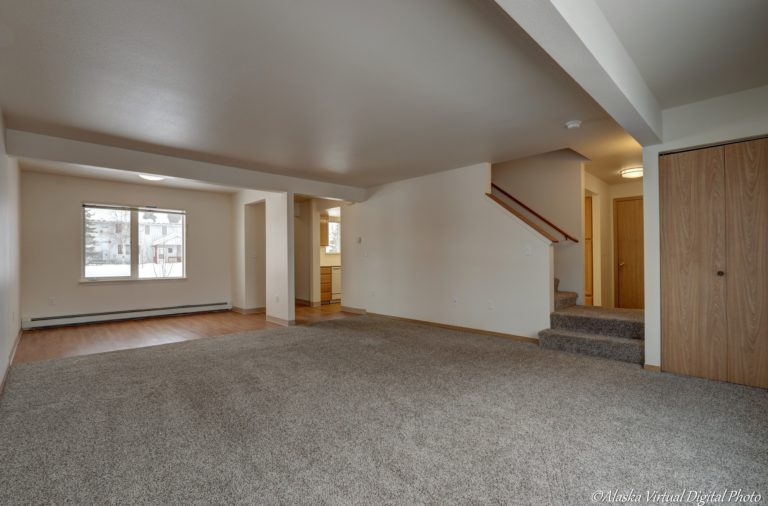 large living area with stairway