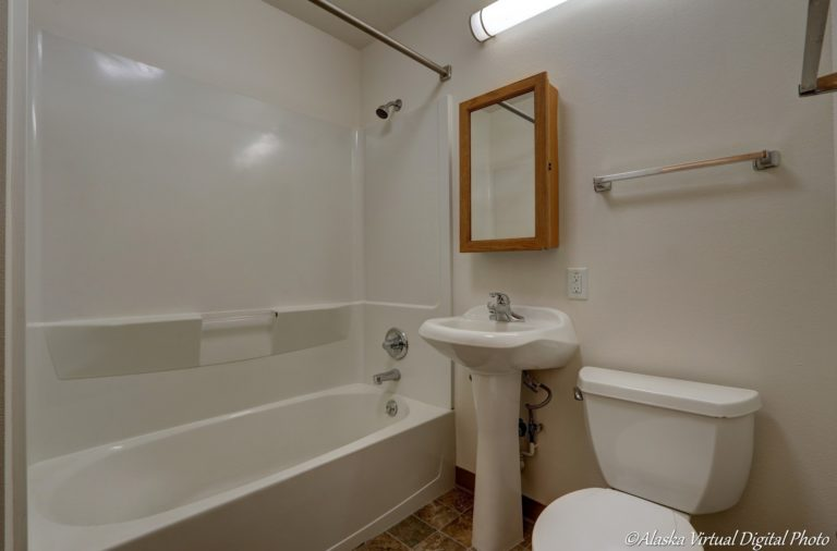 Bathroom with pedestal sink and bathtub