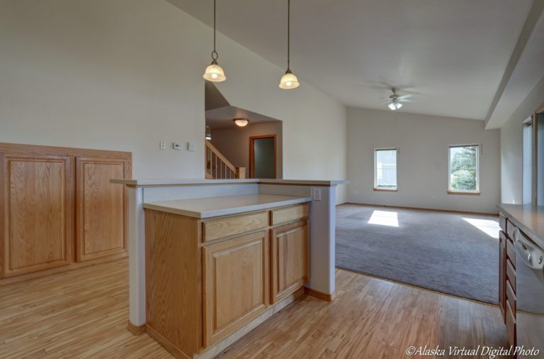View of kitchen island looking into living/rec area