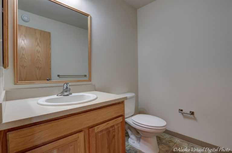 Image of powder room with white counters