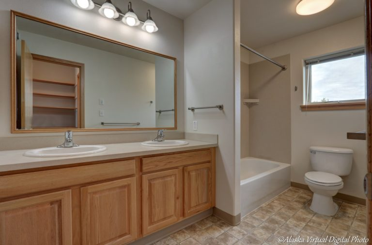 Master bath with double sinks and tub/shower