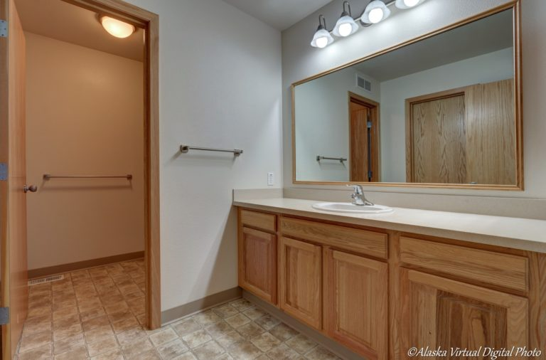 Bathroom with large vanity and sink
