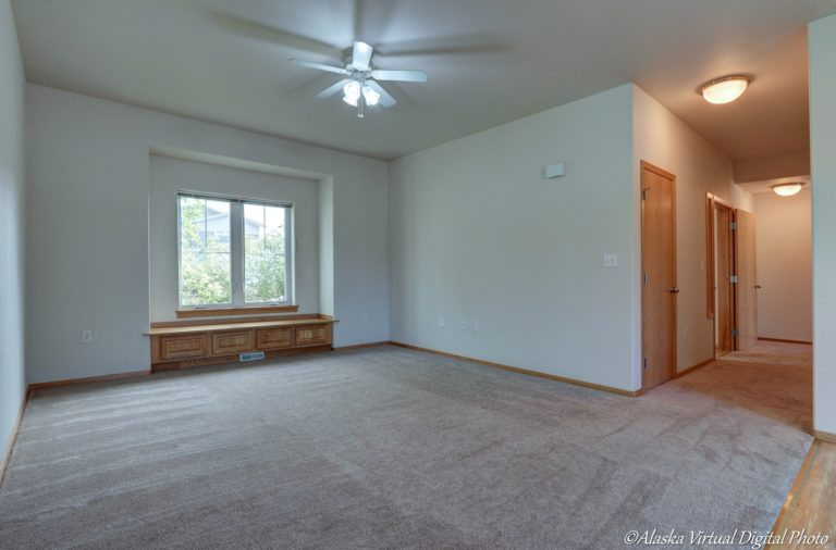 Living room with built in bench near windows