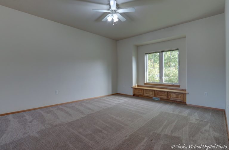 Living room with built in bench and fan.