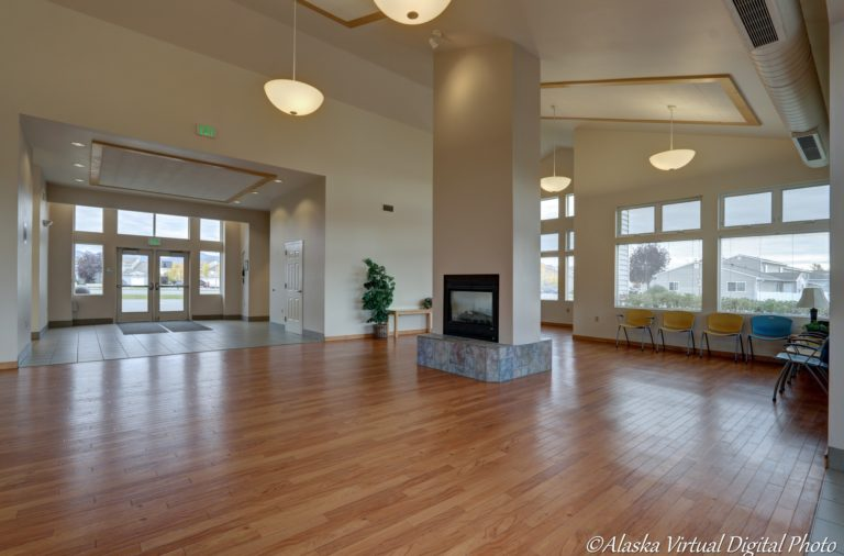 image of entertainment area with fireplace and wood floors