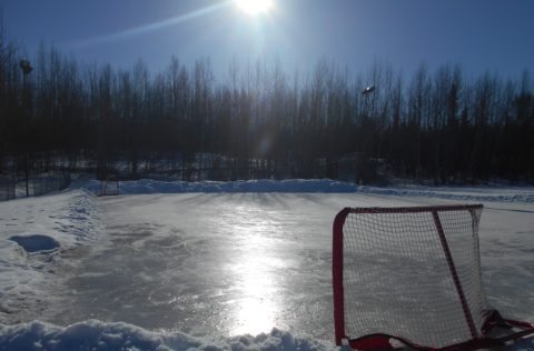 An outdoor hockey rink that has been cleared