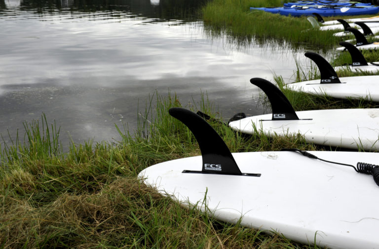 Stand-up-paddle boards are lined up for use by participants during Otter Fest hosted by Outdoor Recreation Center on Joint Base Elmendorf-Richardson, Alaska, July 27. The stand-up-paddle-board race was one of five events during the inaugural Otter Fest.