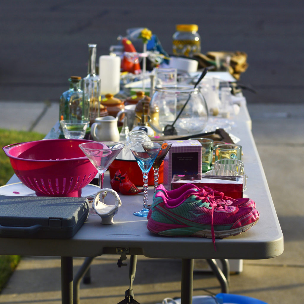 stuff on a table outside at a yard sale