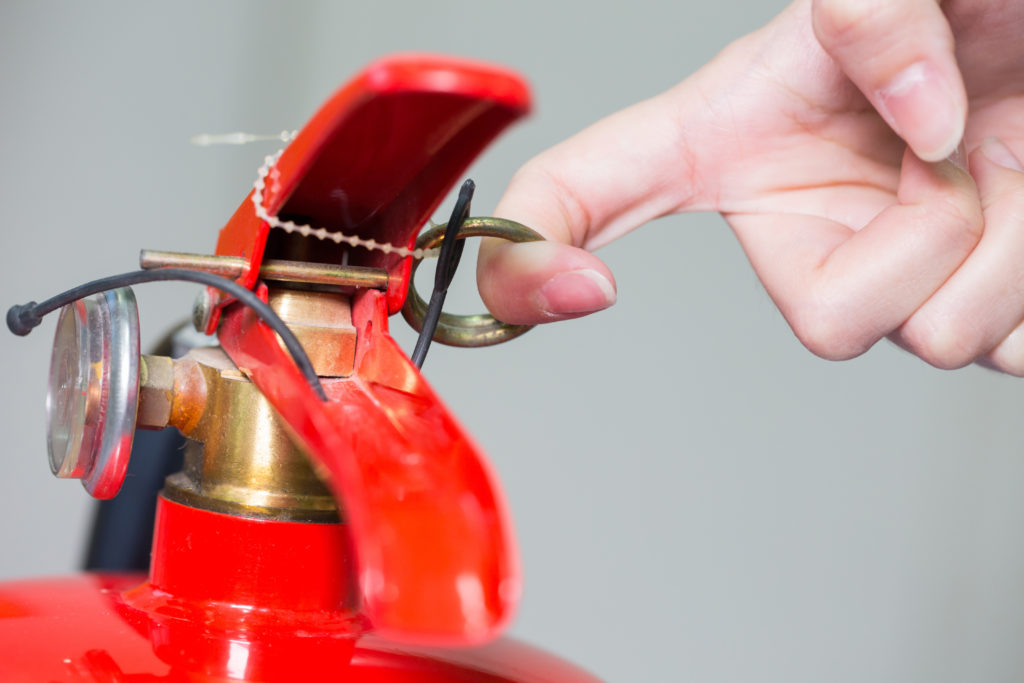 close up image of red fire extinguisher