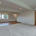 Living room of home with carpet and tile for dining room