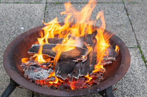 metal fire pit on stone material