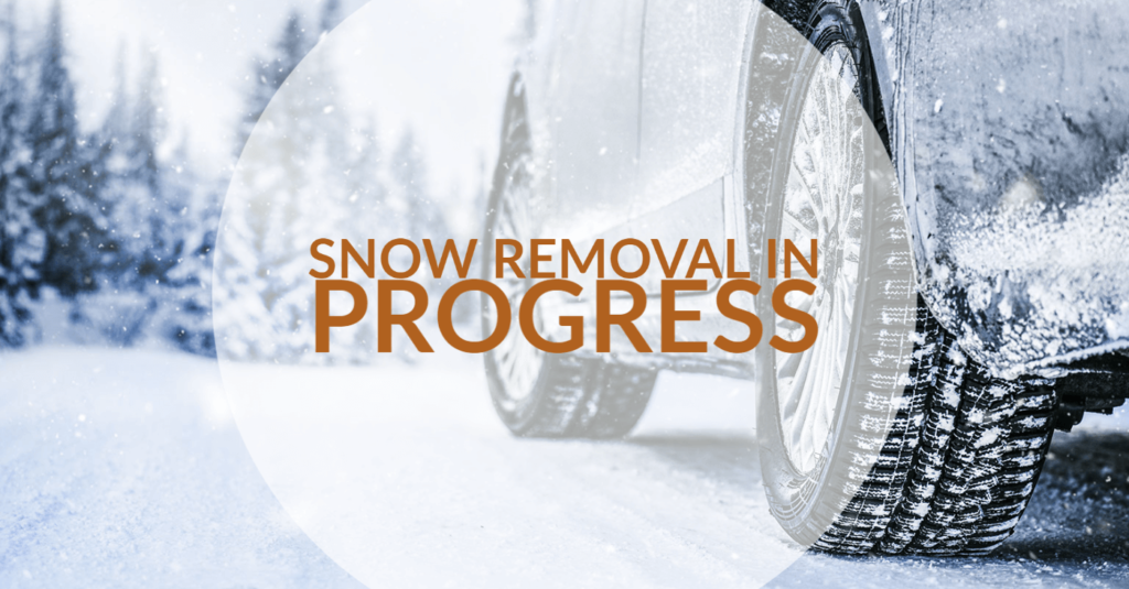 car on snowy road with snow removal in progress text transposed over